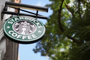154211248-the-signage-on-a-branch-of-starbucks-coffee-on-october.jpg.CROP.promovar-mediumlarge